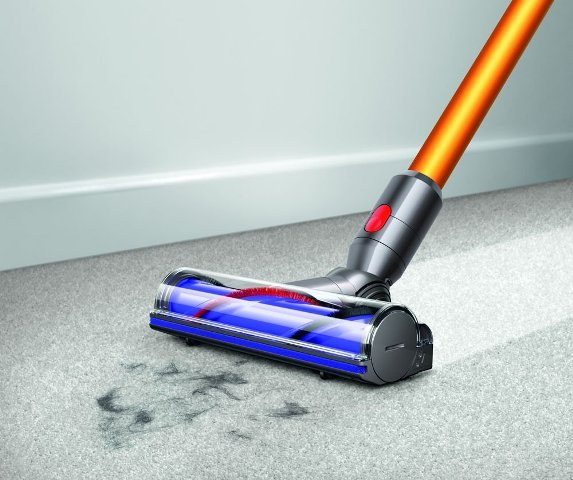 Dyson cordless vacuum cleaner cleaning tiles